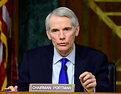 """United States Senator Rob Portman (Republican of Ohio) questions witnesses as they testify before the US Senate Committee on Homeland Security and Governmental Affairs Permanent Subcommittee on Investigations during a hearing on """"Examining Private Sector Data Breaches"""" on Capitol Hill in Washington, DC on Thursday, March 7, 2019.<br /> Credit: Ron Sachs / CNP"""