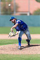Team Italy relief pitcher Valerio Simone (14) delivers a pitch during an exhibition game against the Oakland Athletics at Lew Wolff Training Complex on October 3, 2018 in Mesa, Arizona. (Zachary Lucy/Four Seam Images)