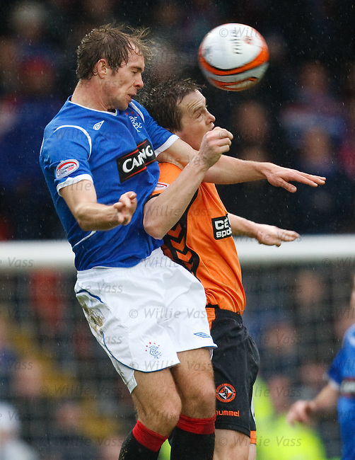 Steven Whittaker heads the ball out of defence