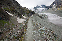Atop the lateral moraine of the Glacier du Moiry, Switzerland. The Cabane du Moiry can be seen atop the ridgeline to the left of the center of the photo.