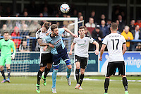 Andy Monkhouse of Grimsby Town (3rd right) in an aerial battle during the Vanarama National League match between Dover Athletic and Grimsby Town at the Crabble Athletic Ground, Dover, England on 16 April 2016. Photo by Tony Fowles/PRiME Media Images.