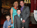 Lorcan Mallon from Congress Avenue school who received first holy communion in St Mary's church pictured with parents Ivan and Suzanne and brother Donnacha. Photo: Colin Bell/pressphotos.ie