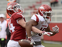 NWA Democrat-Gazette/ANDY SHUPE<br /> Arkansas receiver Tyson Morris (right) reaches to catch a pass Saturday, April 6, 2019, as defensive back Nathan Parodi defends during the Razorbacks' spring game in Razorback Stadium in Fayetteville. Visit nwadg.com/photos to see more photographs from the game.
