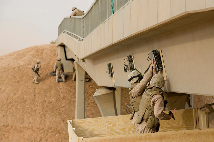 Marines with Charlie Company, 1st Combat Engineer Battalion attach C4 to Bridge 18 near Ar Rutbah, Iraq, Saturday, December 1, 2007. The Marines are demolishing the bridge because it was hit by an Improvised Explosive Device in August, causing the bridge to sag and be unsafe. Numerous trucks have hit the top of the bridge due to its lowered height. 1st CEB is deployed with Multi National Forces-West in support of Operation Iraqi Freedom in the Al Anbar province of Iraq to develop Iraqi Security Forces, facilitate the development of official rule of law through democratic reforms, and continue the development of a market based economy centered on Iraqi reconstruction. (Official USMC photograph by Cpl. Shane S. Keller)