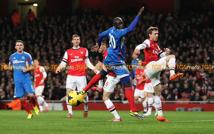 Yannick Sagbo of Hull goes close to getting on the end of a cross in the 1st half - Arsenal vs Hull City, Barclays Premier League at the Emirates, Arsenal - 04/12/13 - MANDATORY CREDIT: Rob Newell/TGSPHOTO - Self billing applies where appropriate - 0845 094 6026 - contact@tgsphoto.co.uk - NO UNPAID USE