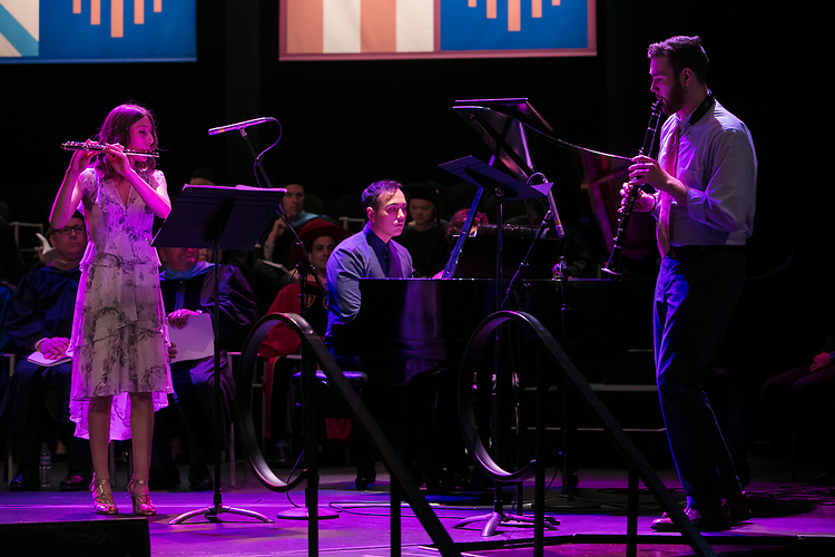 Left to right, Emily Jeanne DePalma, John-Paul D. Pendowski, and Daniel Thomas Hickey perform a piece by 19th century composer Camille Saint-Saëns Saturday, June 10, 2017, during the DePaul University School of Music and The Theatre School commencement ceremony at the Rosemont Theatre in Rosemont, IL. (DePaul University/Jeff Carrion)