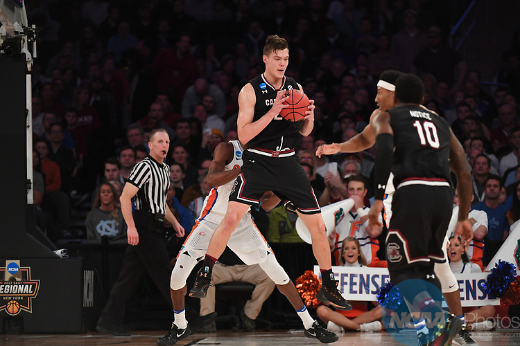 NEW YORK, NY - MARCH 26: Chris Silva #30 of the South Carolina Gamecocks is guarded by Kevarrius Hayes #13 of the Florida Gators during the 2017 NCAA Men's Basketball Tournament held at Madison Square Garden on March 26, 2017 in New York City. (Photo by Justin Tafoya/NCAA Photos via Getty Images)