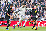 Alvaro Morata of Real Madrid competes for the ball with David Lopez and Javi Fuego during the match of La Liga between Real Madrid and RCE Espanyol at Santiago Bernabeu  Stadium  in Madrid , Spain. February 18, 2016. (ALTERPHOTOS/Rodrigo Jimenez)