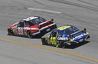 May 6, 2007; Richmond, VA, USA; Nascar Nextel Cup Series driver Carl Edwards (99) leads Jimmie Johnson (48) during the Jim Stewart 400 at Richmond International Raceway. Mandatory Credit: Mark J. Rebilas