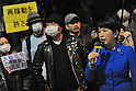 Mizuho Fukushima, a member of the House of Councillors for the Social Democratic Party, talks as anti nuclear power demonstrators protest in front of the official residence of Japanese Prime Minister Noda in Tokyo as the Japanese parliament discusses restarting one of Japan's nuclear power plants on April 6, 2012.