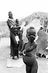 A Turkana woman and child in a traditional village near Kakuma, Northern Kenya.