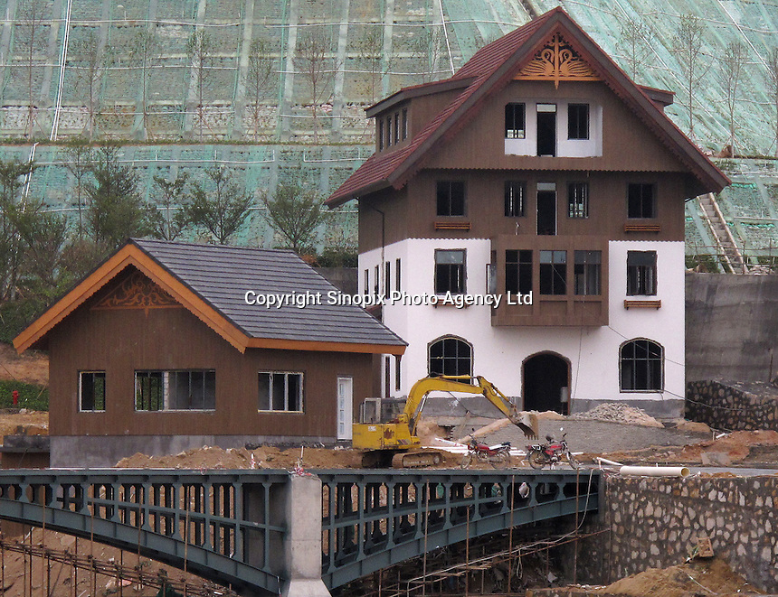 20120116 CHINA GUANGDONG PROVINCE : An unfinished bridge and building are seen in Hallstatt, China's copy of the Austrian alpine town of the same name, Boluo Township, Huizhou City, Guangdong Province, China, 16 January 2012. Property developments such as this are expected to run into financial difficulites in 2012 as the Chinese economy and property market continue to cool, in reaction to the ongoing sovereign debt crisis in Europe.<br /> SINOPIX / ALEX HOFFORD