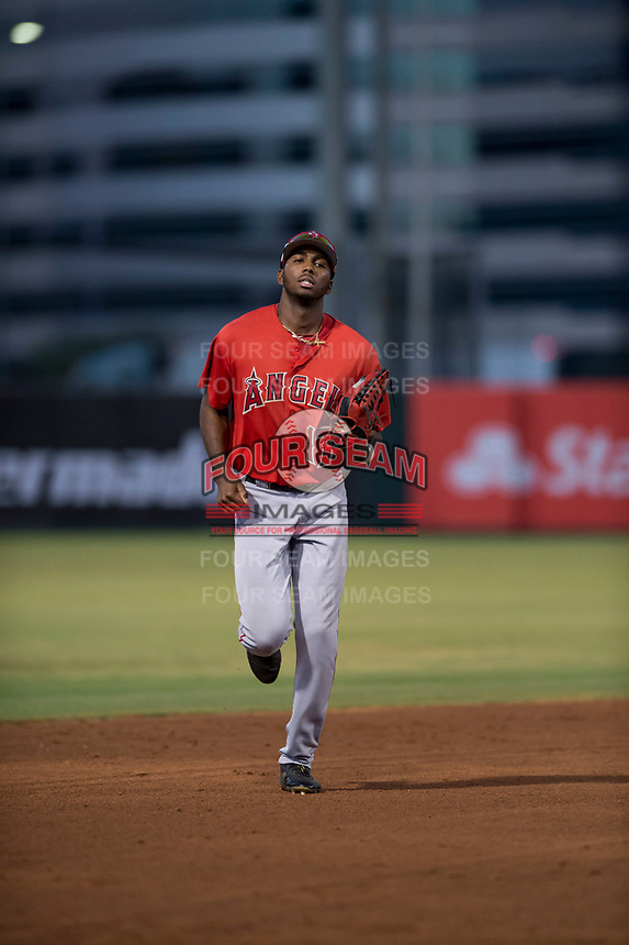 AZL Angels center fielder Trent Deveaux (17) jogs off the field between innings of an Arizona League game against the AZL Indians 2 at Tempe Diablo Stadium on June 30, 2018 in Tempe, Arizona. The AZL Indians 2 defeated the AZL Angels by a score of 13-8. (Zachary Lucy/Four Seam Images)