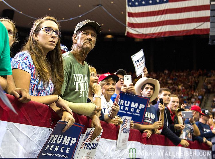 JACKSONVILLE, FL - AUGUST 03:  Supporters listen to Republican presidential nominee Donald Trump speak at Jacksonville Veterans Memorial Arena on August 3, 2016 in Jacksonville, Florida. (Photo by Mark Wallheiser/Getty Images)