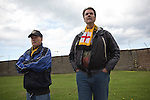 Home supporters, including a man with a scarf featuring an English St. George's cross flag, watching the action during the first half at Shielfield Park, during the Scottish League Two fixture between Berwick Rangers and East Stirlingshire. The home club occupied a unique position in Scottish football as they are based in Berwick-upon-Tweed, which lies a few miles inside England. Berwick won the match by 5-0, watched by a crowd of 509.