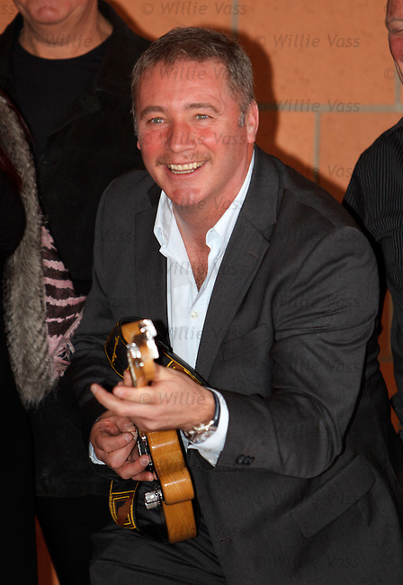 Ally McCoist with Bruce Springsteen tribute band The Rising who paid a visit to Murray Park meet the Boss of Rangers