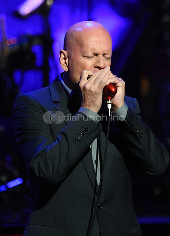 NEW YORK, NY - March 9 : Bruce Willis Performs on stage at 'Love Rocks NYC! A Change is Gonna Come: Celebrating Songs of Peace, Love and Hope' A Benefit Concert for God's Love We Deliver at Beacon Theatre on March 9, 2017 in New York City. @John Palmer / Media Punch
