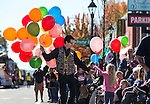 Mark Schmidt, with Carson Jewelry &amp; Loan hands out balloons at the annual Nevada Day parade in Carson City, Nev. on Saturday, Oct. 29, 2016. <br />