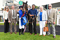 Connections of Cotton Club in the winners enclosure after winning The Bathwick Tyres Handicap, during Afternoon Racing at Salisbury Racecourse on 13th June 2017