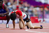 03 AUG 2012 - LONDON, GBR - Kishimoto Takayuki (JPN) of Japan  recovers after finishing his men's 400m hurdles heat during the London 2012 Olympic Games athletics at the Olympic Stadium in the Olympic Park in Stratford, London, Great Britain .(PHOTO (C) 2012 NIGEL FARROW)