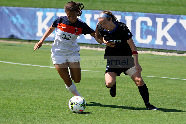 Kentucky senior Stuart Pope fights a Pepperdine defender for the ball during the first half of the women's soccer game against Pepperdine at the Wendell and Vickie Bell Soccer Complex in Lexington, Ky., on Sunday, September 14, 2014. Photo by Jonathan Krueger | Staff