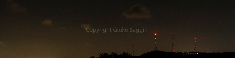 The red lights of the television towers on Mt Coot-tha in Brisbane glimmer in the night sky.
