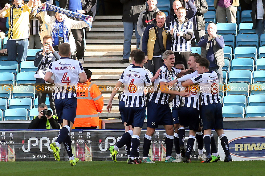 Millwall players congratulate Shane Ferguson (No 18) after scoring their second goal during Millwall vs Scunthorpe United, Sky Bet EFL League 1 Football at The Den on 1st April 2017