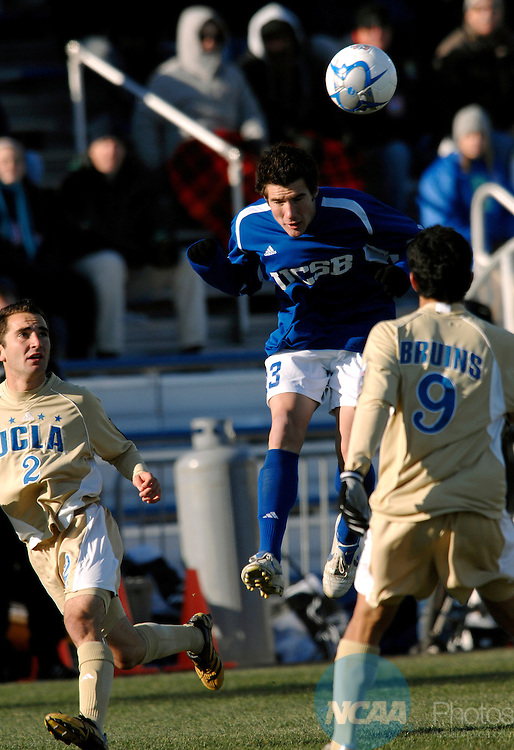 03 DEC 2006:  Chris Pontius (13) of UC Santa Barbara jumps to head the ball Jason Leopoldo (2) and Tony Beltran (9) of UCLA look on during the Division l Men's Soccer Championship held at Robert R. Hermann Stadium in St. Louis, MO. The University of California Santa Barbara defeated UCLA 2-1 for the national title. Scott Rovak/NCAAPhotos