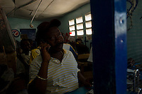 Leogane, Haiti, Jan 24 2010.<br /> Economic activity is slowly starting up again, sometimes in strange ways...a small bookmaking office is in full activity. Closest town from the epicenter, Leogane is almost totally destroyed, no building is intact, the inhabitants live in makeshift shelters.