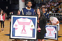 25 February 2012:  FIU's Brandon Moore (22) presents a jersey to Cathy Bruich during a ceremony honoring cancer survivors prior to the game.  The FIU Golden Panthers defeated the University of South Alabama Jaguars, 81-74, at the U.S. Century Bank Arena in Miami, Florida.