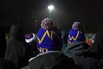 City of Liverpool 6 Holker Old Boys 1, 10/12/2016. Delta Taxis Stadium, North West Counties League Division One. Home supporters in bobble hats watching the closing stages of the match at the Delta Taxis Stadium, Bootle, Merseyside as City of Liverpool hosted Holker Old Boys in a North West Counties League division one match. Founded in 2015, and aiming to be the premier non-League club in Liverpool, City were admitted to the League at the start of the 2016-17 season and were using Bootle FC's ground for home matches. A 6-1 victory over their visitors took 'the Purps' to the top of the division, in a match watched by 483 spectators. Photo by Colin McPherson.
