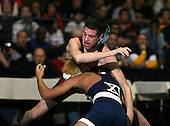Ken Collado of Hauppauge (XI) and Luke Popolizio of Shenendehowa (II) square off in the NY State finals at the 103 weight class during the NY State Wrestling Championship finals at Blue Cross Arena on March 9, 2009 in Rochester, New York.  (Copyright Mike Janes Photography)