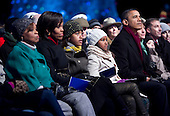 United States President Barack Obama, accompanied by Marian Robinson, Michelle Obama's mother, left to right, First Lady Michelle Obama, and their daughters Malia and Sasha, watch during the National Christmas Tree lighting ceremony on the Ellipse near the White House in Washington, DC, on Thursday, December 9, 2010. The first Christmas tree lighting ceremony took place back in 1923, with U.S. President Calvin Coolidge presiding. .Credit: Andrew Harrer / Pool via CNP