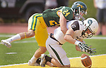 SPEARFISH, SD: SEPTEMBER 2: James Holtrop #1 of Adams State couldn't get a handle on a pass in the end zone while defended by Drew Hebel #24 of Black Hills State during their game Saturday at Lyle Hare Stadium in Spearfish, S.D.   (Photo by Dick Carlson/Inertia)