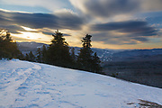 Sunrise from the summit of Mount Pemigewasset in Lincoln, New Hampshire USA on a cloudy winter morning.