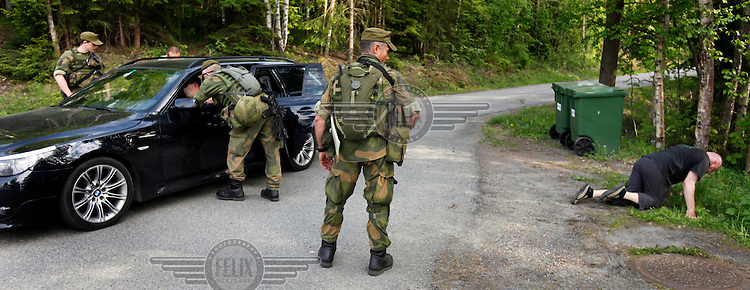 Norwegian Home Guard soldiers during exercise Djerv encounters a simulated drunk driver situation. .The Home Guard has traditionally been designated to secure important  domestic installations in case of war or crisis. With the cold war long gone, a war in Afghanistan and budget cuts, there is a debate over the Home Guard's role in the future.