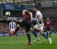 Huddersfield Town's Aaron Mooy (left) clears the ball as he comes under pressure from Brighton & Hove Albion's Florin Andone (right) <br /> <br /> Photographer David Horton/CameraSport<br /> <br /> The Premier League - Brighton and Hove Albion v Huddersfield Town - Saturday 2nd March 2019 - The Amex Stadium - Brighton<br /> <br /> World Copyright © 2019 CameraSport. All rights reserved. 43 Linden Ave. Countesthorpe. Leicester. England. LE8 5PG - Tel: +44 (0) 116 277 4147 - admin@camerasport.com - www.camerasport.com