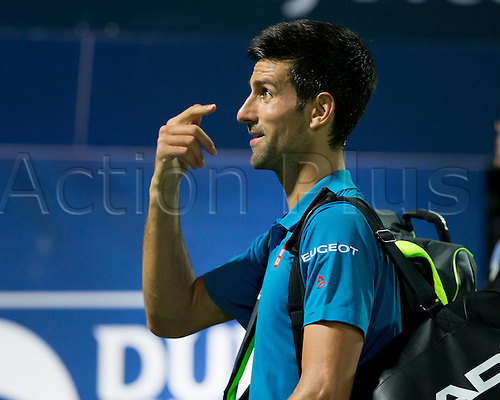 25.02.2016. Dubai, UAE.  Novak Djokovic (Srb) responding and annoyed at the comments from Spectators as he retires injured and leaves the court at the quarterfinals of the Dubai Duty Free Tennis Championships