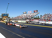 Mar 14, 2014; Gainesville, FL, USA; NHRA top fuel dragster driver Clay Millican (near lane) races alongside Bob Vandergriff Jr during qualifying for the Gatornationals at Gainesville Raceway Mandatory Credit: Mark J. Rebilas-USA TODAY Sports
