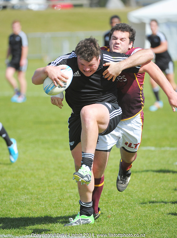 Action from the Under-19 provincial Michael Jones Trophy semifinal match between Heartland (black) and Southland (maroon) at Owen Delaney Park, Taupo, New Zealand on Wednesday, 1 October 2014. Photo: Dave Lintott / lintottphoto.co.nz