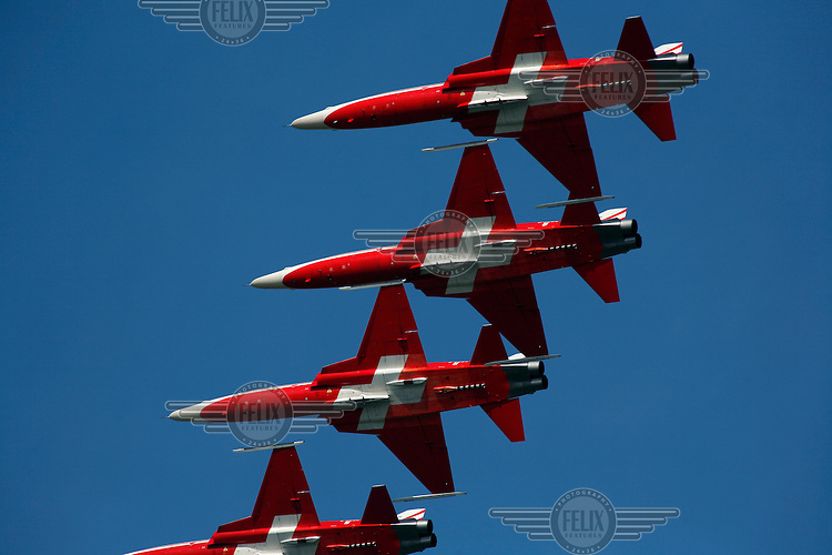 Patrouille Suisse aerobatics team flying Northrop F-5 fighter plane. 100 years of Norwegian aviation was celebrated with an airshow at Rygge Airbase. May 5th 1909, Norsk Luftseiladsforening, the predecessor of the Norwegian Air Sports Federation, was founded, and became the start of organised aviation and air sports in Norway. Since then there's been major developments within military and civilian aviation, as well as within the various air sports activities.  .©Fredrik Naumann/Felix Features.