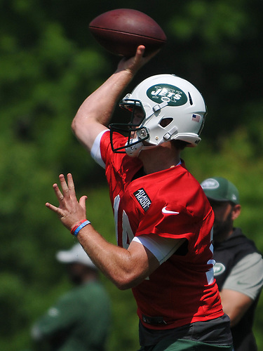 Sam Darnold #14, New York Jets quarterback, throws a pass during OTAs held at the Atlantic Health Jets Training Center in Florham Park, NJ on Tuesday, May 29, 2018.