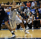 Chloe Wells tries to go around a Virginia player. Duke woman's basketball beat Virginia 77-66 on Monday, January 2, 2012 at Cameron Indoor Stadium in Durham, NC. Photo by Al Drago.