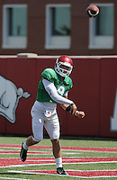 NWA Democrat-Gazette/ANDY SHUPE<br /> Arkansas quarterback Rafe Peavey passes Tuesday, Aug. 11, 2015, during practice at the university's practice field in Fayetteville.