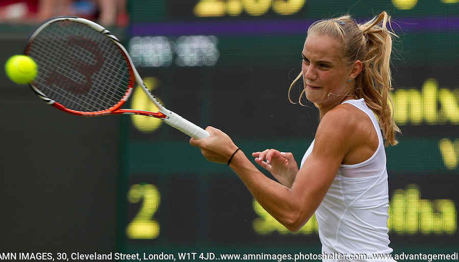 ARANTXA RUS..Tennis - Grand Slam - The Championships Wimbledon - AELTC - The All England Club - London - Wed June 27th 2012. .© AMN Images, 30, Cleveland Street, London, W1T 4JD.Tel - +44 20 7907 6387.mfrey@advantagemedianet.com.www.amnimages.photoshelter.com.www.advantagemedianet.com.www.tennishead.net