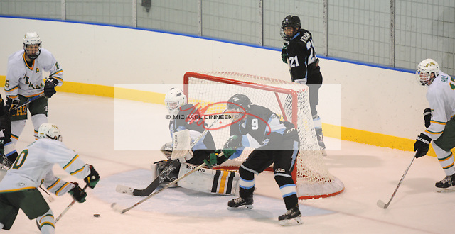 Mustangs' goalie Jack Walters makes a save on Service's Owen Crumley as Kadin Yokey helps out at Ben Boeke, Saturday, November 12, 2016.  Photo for the Star by Michael DInneen