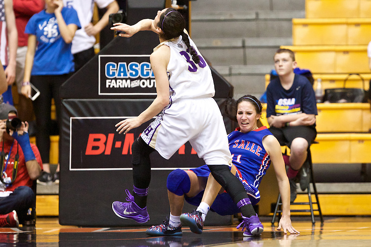 Mar 11, 2015; Portland, OR, USA; La Salle Prep guard Aleah Goodman reacts after drawing a foul on Hermiston Bulldogs guard Sara Ramirez in the 5A Girls Basketball State Championship at Gill Coliseum.<br /> Photo by Jaime Valdez