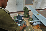 "Ori Gonen, commander of ""Skylark"" UAV unit, inspects a remote control, at Palmachim Israeli Airforce base."