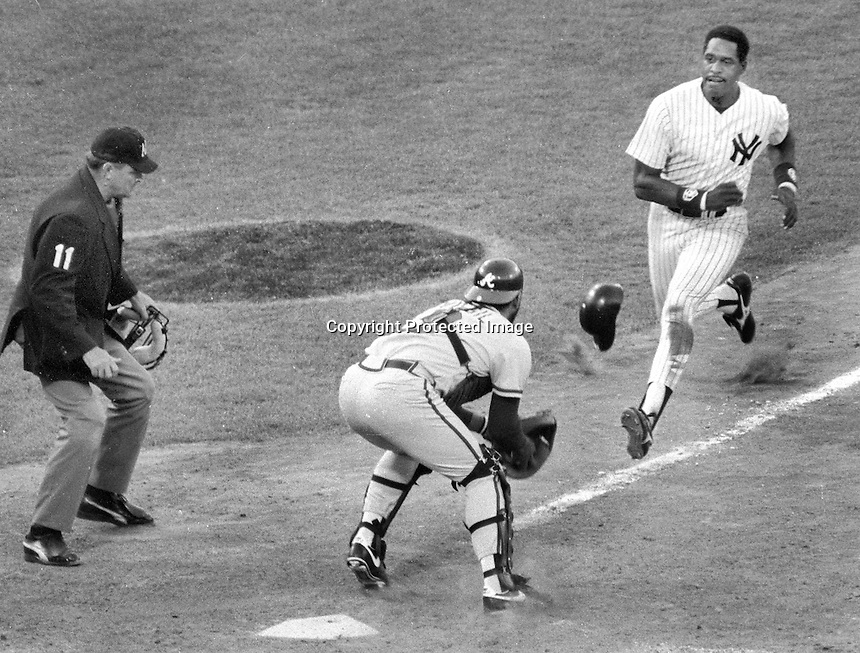 Yankees Dave Windfield coming down the line against catcher Ozzie Virgil Jr. who tagged him out. Umpire Don Denkinger..(1987 All-Star game in Oakland.)<br />