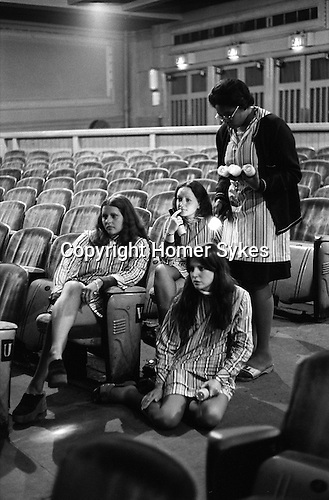 "Wings Tour 1975, Liverpool rehearsal,  usherettes listen a sound check. The photographs from this set were taken in 1975. I was on tour with them for a children's ""Fact Book"". This book was called, The Facts about a Pop Group Featuring Wings. Introduced by Paul McCartney, published by G.Whizzard. They had recently recorded albums, Wildlife, Red Rose Speedway, Band on the Run and Venus and Mars. I believe it was the English leg of Wings Over the World tour. But as I recall they were promoting,  Band on the Run and Venus and Mars in particular."